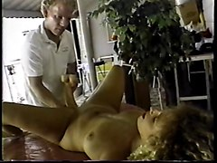 Big-titted blonde fucks herself with double-headed dildo