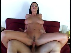 Stunning dark haired slut with tattoo and big tits loves to ride big dick