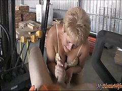 Tracy Licks gives young guy a blow job on a tractor