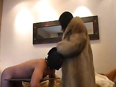 Asian femdom in fur coat punish his slave