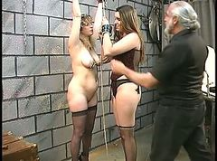 Brunette teen slave with gag ball gets her nipples and pussy clamped