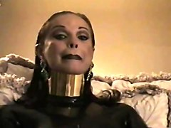 brunette - posture collar, heavy makeup + smoking