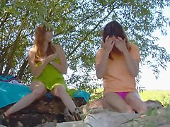 Two girls masturbation in the outdoors