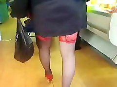 Girl in black stockings with red tops