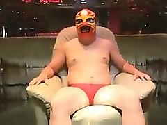 chubby dude in a lucha libre mask is seduced by a hot asian