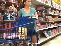 big tits milf filmed around in a department store by voyeur