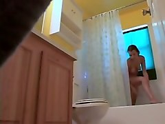 hidden camera in the bathroom catches my flatmate shaving her pussy