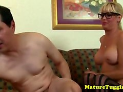 busty spex milf in stockings jerking cock