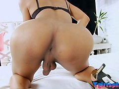 curvy shemale fucks her asshole with a dildo on the bed