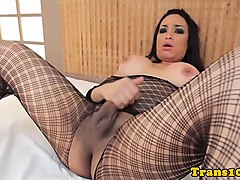 latina shemale pleasures herself with dildo