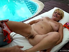 granny fucks next to a pool
