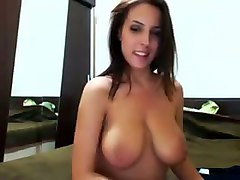 seductive brunette babe sucking her own nipples