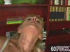Horny granny fucks in home library