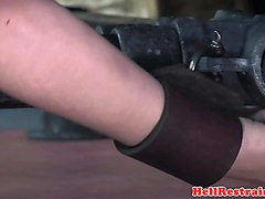 cuffed slave clit stimulated while restrained