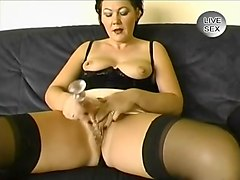 Euro Milf in Stockings Masturbates