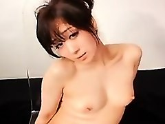 stunning asian girl in stockings works her juicy cunt on a