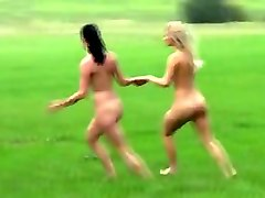 two beautiful amateur girls running all naked in a countryside