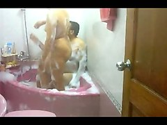 chunky indian housewife with her hubby in the bathtub