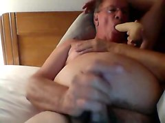 Jerk off in bed while sucking dildo