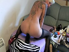 tattooed granny riding big dildo in amateur clip