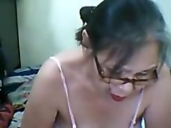Asian granny plays with dildo