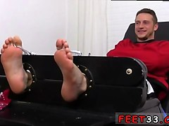 tied up hunk gets his feet teased in this kinky session