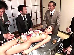 business men eat sushi out of a naked girl&039s body