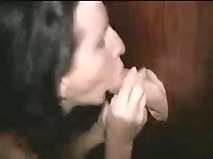 sucking this guy's cock through a gloryhole in the most explicit way imaginable
