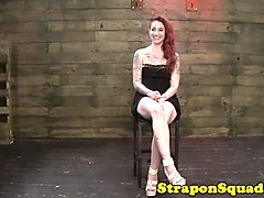 inked redhead gagging on strapon in dom trio
