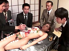 business men eat sushi out of a naked girls body