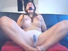 boobalicious mom masturbating with dildo in kinky solo video