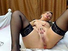 sassy mature lady in sexy stockings is wildly masturbating on cam