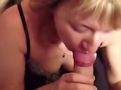 Cock greedy blonde milf sucks hard cock greedily at home