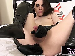 latex femboy toys her ass with dildo