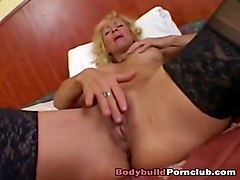 mature old slut with big tits and shaved pussy gets her pussy stretched wide
