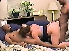 Horny blonde milf sucks black cock while second black dude fucks her