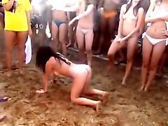 Wet wild party outdoor on beach with nude and topless babes having fun