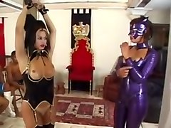 Latex mistress dominate a shemale and 2 guys