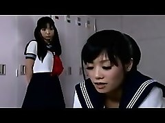 two adorable japanese schoolgirls kiss each other in the lo