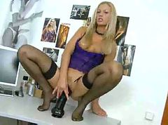 Girl in black stockings with huge dildo