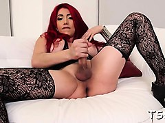 lady-boy plays with her beefy stick and jerks if off nicely