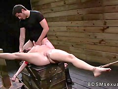 Tied to a crate and spread brunette Stella May roughly fucked