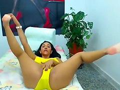 Busty brunette in a yellow bikini shows off her ass on webc