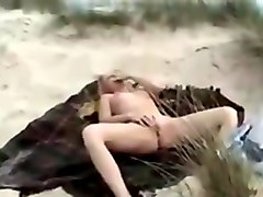 Blonde has sex with strangers on a beach