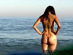 voyeur beach nudity video sexy nudists  liyng on the beach