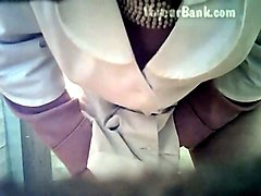 white lady in black nylon pantyhose pisses in the toilet