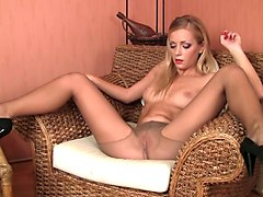 magnificent blonde teen babe with big eyes strips on cam