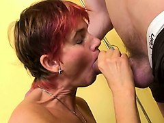 horny and hot mature woman seduces a young man on the bed