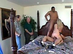 mesmerizing blonde milf wife on the bed with two black men