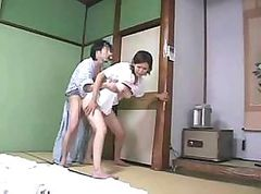 Asian babe gives a blowjob and fucks her man on the floor